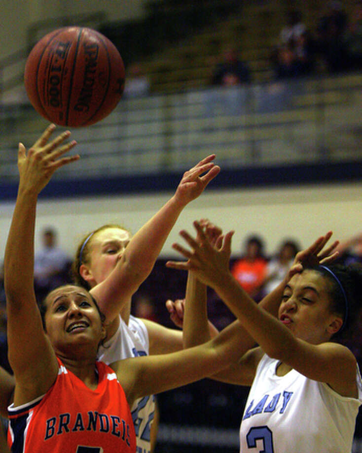 Brandeis' Daisy Womack fights Johnson's Sabriya Goldstone for the rebound in the first half as Brandeis matched up against Johnson at Littleton Gymnasium, Monday, November 22, 2010. Johnson beat Brandeis 65-54. / special to the Express-News