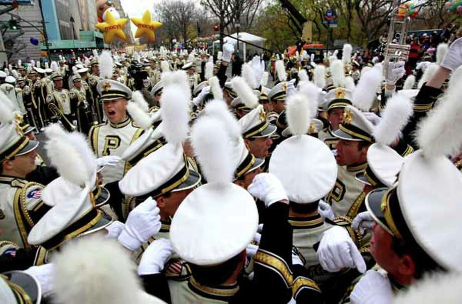 Members of the Purdue University All American Marching Band do a cheer before the start of the Macy's Thanksgiving Day Parade in New York Thursday, Nov. 25, 2010.