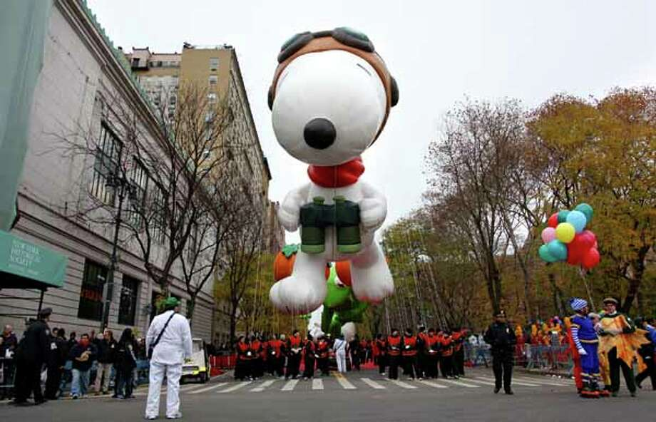 The Macy's Thanksgiving Day Parade was started in 1924 as a Christmas parade by employees of the department store. Since then, it's become part of Thanksgiving and the unofficial start to the Christmas season. Here's a look back at moments from the iconic parade. Sources: Macys.com, WikipediaPHOTO: The balloon Snoopy floats above the street before the start of the Macy's Thanksgiving Day Parade in New York Thursday, Nov. 25, 2010.