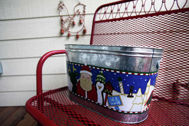 The New Braunfels house is filled with plenty of antiques and Santa-themed items. / © 2010 San Antonio Express-News