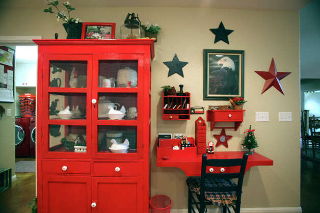 The Smith?s white country kitchen is accented in bright red. The stars serve as a reminder of their Texas heritage. / © 2010 San Antonio Express-News