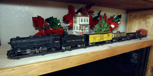 A vintage toy train set adds to the flavor of the d?cor of the Smith house. / © 2010 San Antonio Express-News