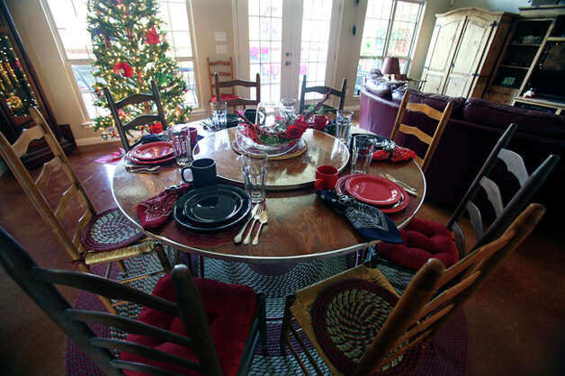 The dining room is set for the holidays. / © 2010 San Antonio Express-News
