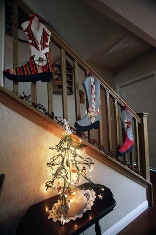 A very merry Christmas staircase. / © 2010 San Antonio Express-News