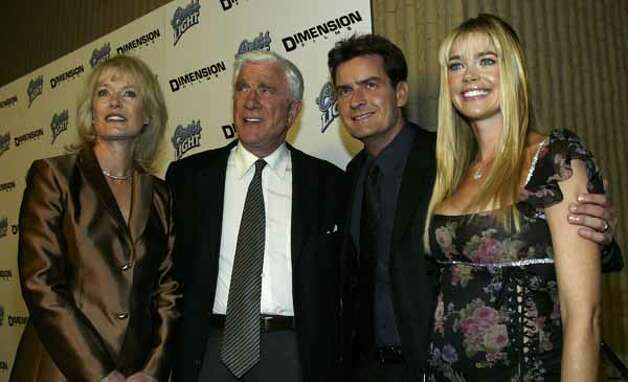 "Mrs. Leslie Nielsen, Leslie Nielsen, Charlie Sheen and Denise Richards attend the film premiere of ""Scary Movie 3"" at the AMC Theatres Avco Cinema on Oct. 20, 2003 in Westwood, California. / 2003 Getty Images"