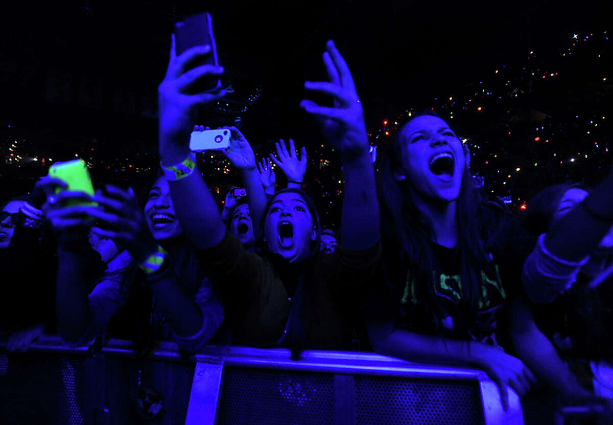Francesca Battah, middle, joins others in cheering for teen singer Justin Bieber at the AT&T Center in San Antonio on Friday, Nov. 5, 2010.