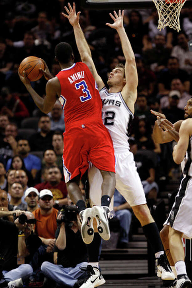 San Antonio Spurs Tiago Splitter defends against a drive by Los Angeles Clippers Al-Farouq Aminu during the first half at the AT&T Center, Wednesday, Nov. 10, 2010. The Spurs went on to win 107-95 and they improve their record 6-1. / glara@express-news.net
