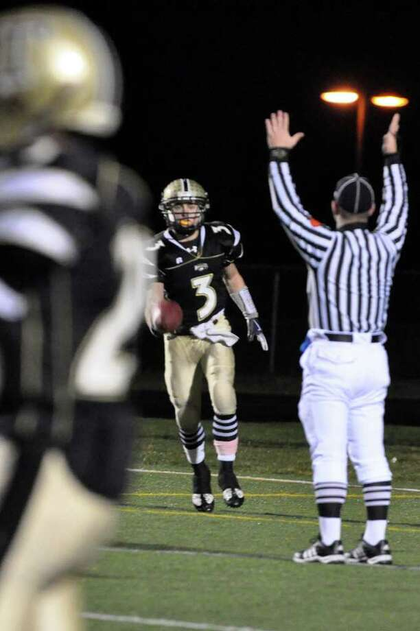 Trumbull's Phil Terio throws the ball to the ref after scoring a touchdown during the CIAC quarterfinal football game against Conard at Trumbull on Tuesday, Nov. 30, 2010. Photo: Amy Mortensen / Connecticut Post Freelance
