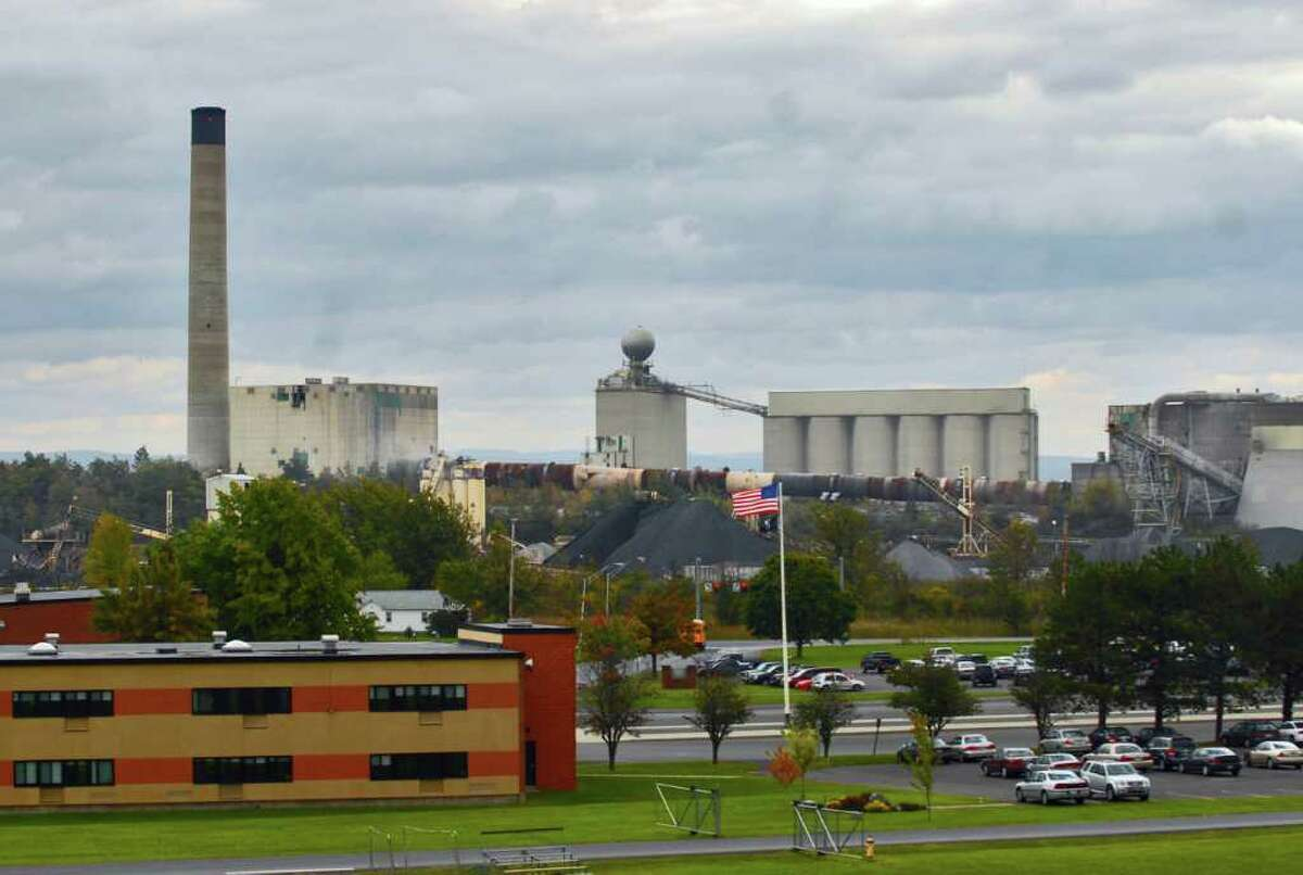 The Lafarge cement plant in Ravena, shown here across Route 9W from the Ravena-Coeymans-Selkirk High School. Participants in an independant Harvard health study will receive individual test results. (Philip Kamrass / Times Union)