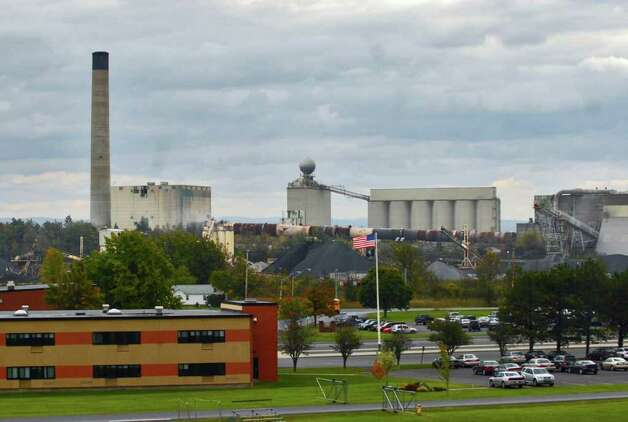 The Lafarge cement plant in Ravena, shown here across Route 9W from the Ravena-Coeymans-Selkirk High School. Participants in an independant Harvard health study will receive individual test results. (Philip Kamrass / Times Union) Photo: PHILIP KAMRASS / 00005722A