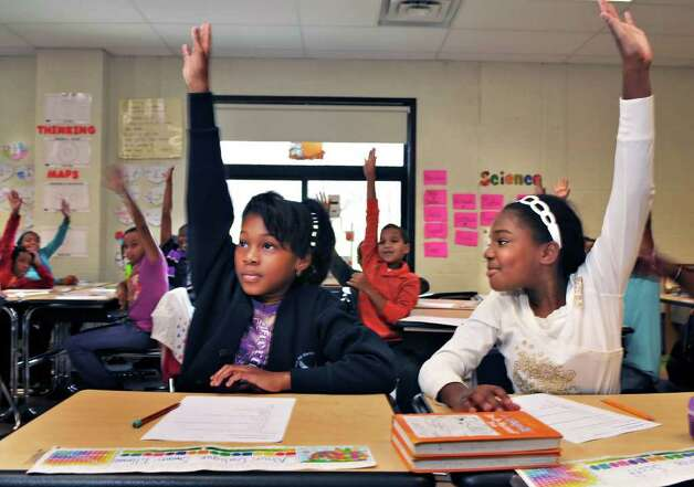 Arbor Hill Elementary School fourth graders Ahun'Galique Swain-Tillma, left, and Jahsharee Scott during class.  (John Carl D'Annibale / Times Union) Photo: John Carl D'Annibale /  00011114A