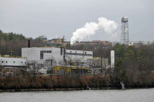 View of part of the the Knolls Atomic Power Laboratory in Niskayuna on Tuesday November 30, 2010, as seen along the Mohawk River.  The building and water tower in the distance on top of the hill, is the neighboring GE global research facility, separate from the Knolls facility. ( Philip Kamrass / Times Union ) Photo: Philip Kamrass