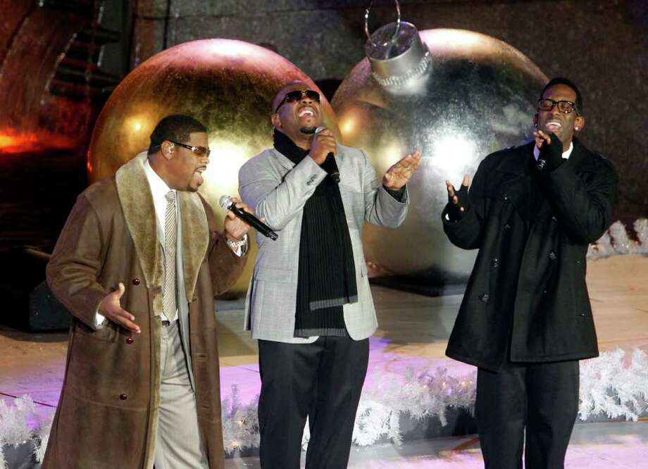 Members of the group Boyz II Men, from left, Nathan Morris, Wanya Morris and Shawn Stockman perform during the 78th annual Rockefeller Center Christmas tree lighting ceremony Tuesday, Nov. 30, 2010, in New York. (AP Photo/Jason DeCrow) Photo: Jason DeCrow