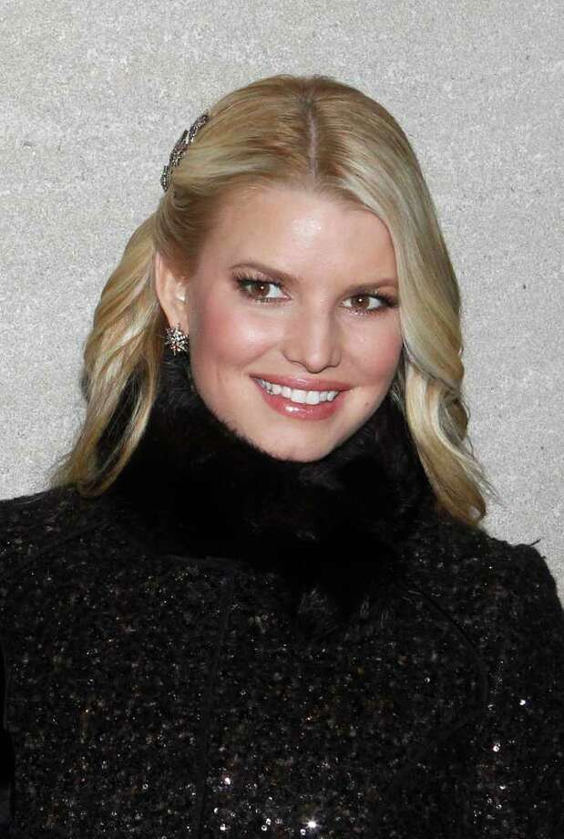 Singer Jessica Simpson poses during the 78th annual Rockefeller Center Christmas tree lighting ceremony Tuesday, Nov. 30, 2010, in New York. (AP Photo/Jason DeCrow) Photo: Jason DeCrow