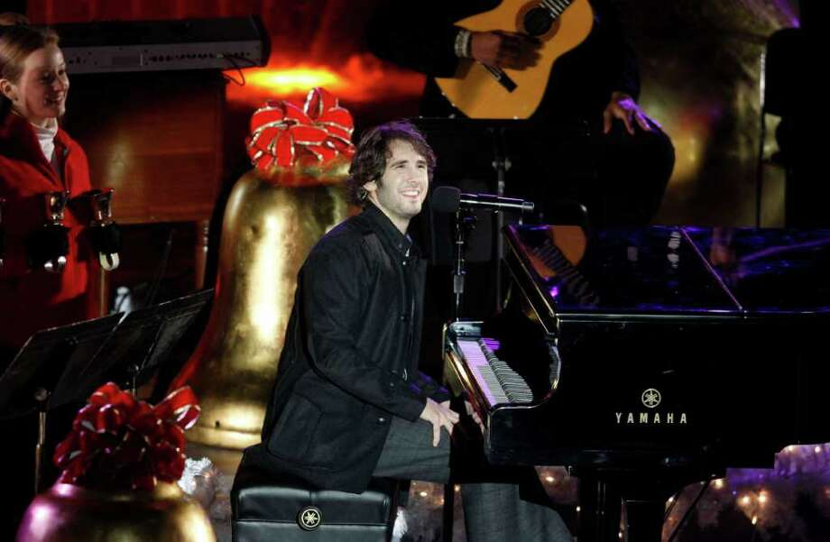 Singer Josh Groban performs during the 78th annual Rockefeller Center Christmas tree lighting ceremony Tuesday, Nov. 30, 2010, in New York. (AP Photo/Jason DeCrow) Photo: Jason DeCrow