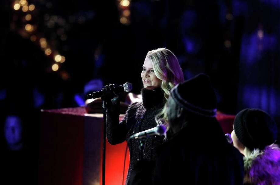 Singer Jessica Simpson performs during the 78th annual Rockefeller Center Christmas tree lighting ceremony Tuesday, Nov. 30, 2010, in New York. (AP Photo/Jason DeCrow) Photo: Jason DeCrow