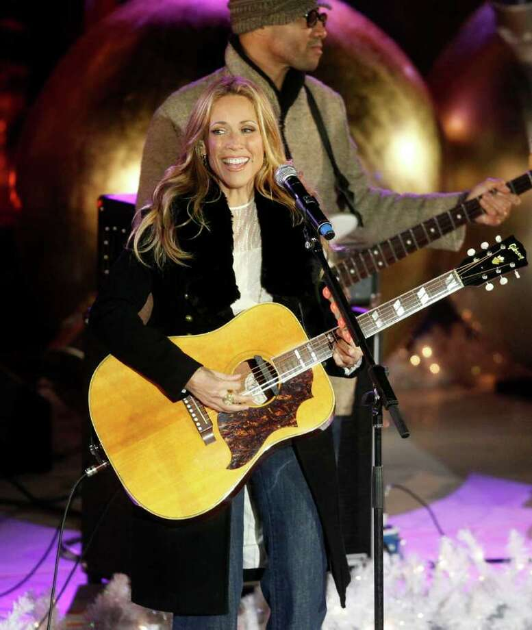 Singer Sheryl Crow performs during the 78th annual Rockefeller Center Christmas tree lighting ceremony Tuesday, Nov. 30, 2010, in New York. (AP Photo/Jason DeCrow) Photo: Jason DeCrow