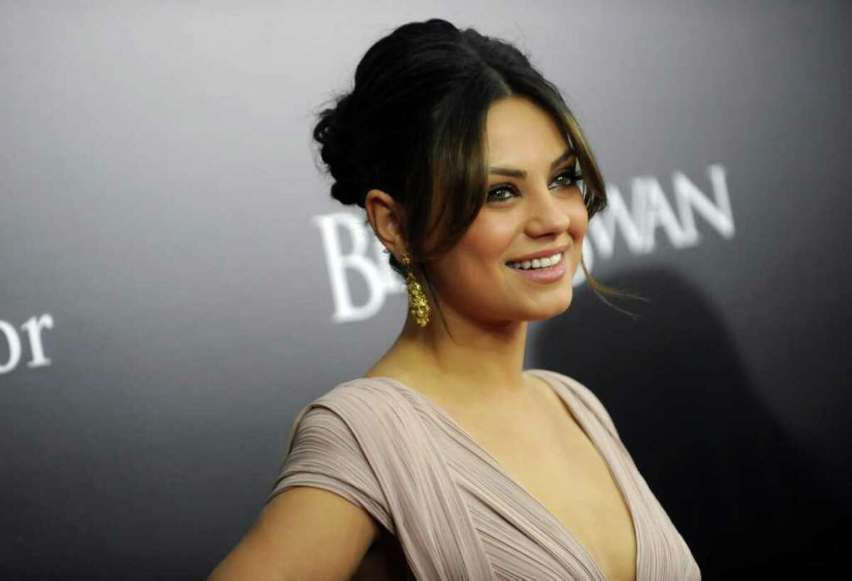 Actress Mila Kunis attends the premiere of 'Black Swan' at the Ziegfeld Theatre on Tuesday, Nov. 30, 2010 in New York. (AP Photo/Evan Agostini)