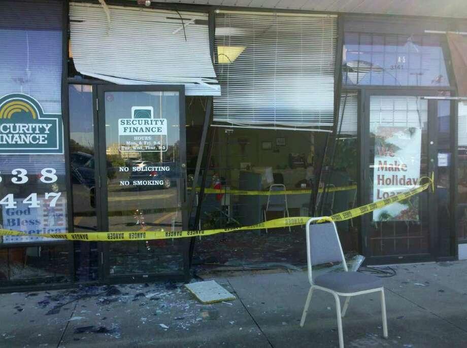 A car ran into Security Finance on Wednesday morning. Teresa Mioli/The Enterprise
