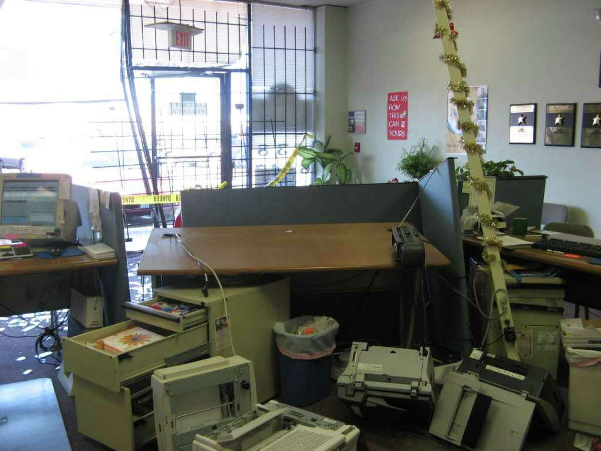 A woman drove a car into an office building on College Street Wednesday morning. The impact knocked over an office desk. Teresa Mioli