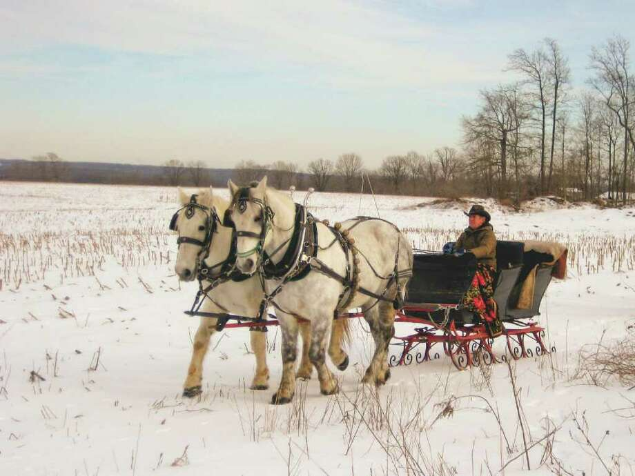 "In Diane Smith's new book, ""Christmas in Connecticut,"" carriage and sleigh rides at Cedar Knoll Farm in Lisbon are among the joyfil things to see and do in the Nutmeg State during the holidays. Photo: Contributed Photo / Norwalk Citizen"
