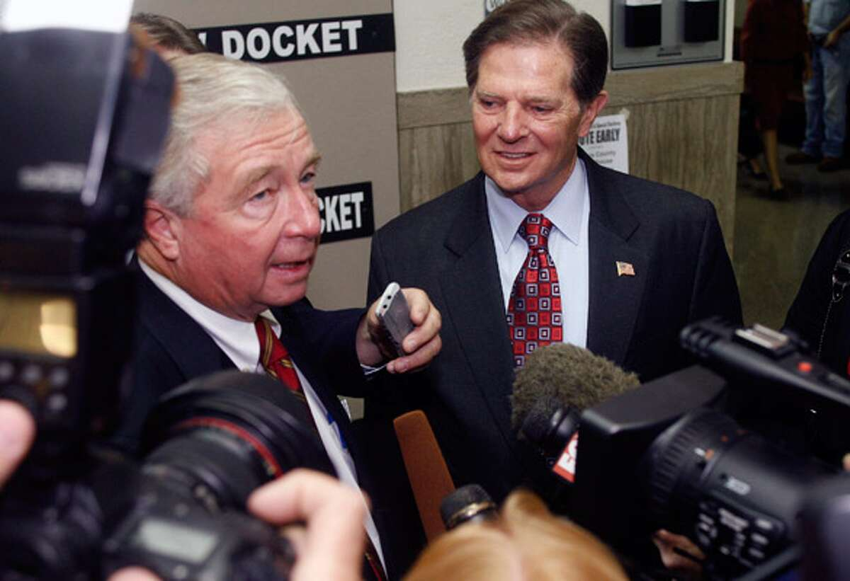 Former House Majority Leader Tom DeLay (right) and attorney Dick DeGuerin answer questions as they arrive at the Travis County courthouse last month.