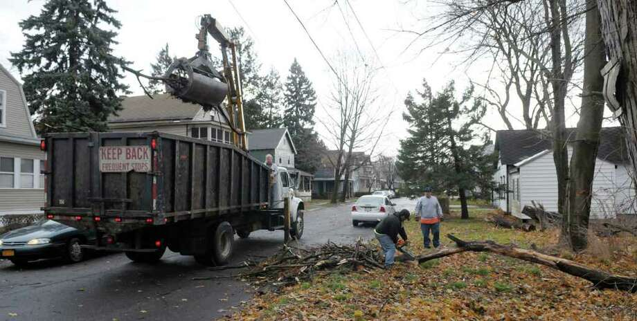 Employees of Troy Department of Public Works clean up a tree which had fallen on Highland Ave. due to high winds on Wednesday.   (Paul Buckowski / Times Union) Photo: Paul Buckowski / 00011276A