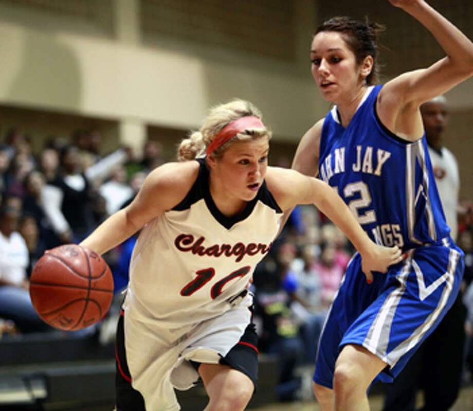 Churchill's Jordan Holub dribbles around Jay's Ashley Mandujano on during the No. 3 Chargers' 70-57 victory over the No. 1 Mustangs.