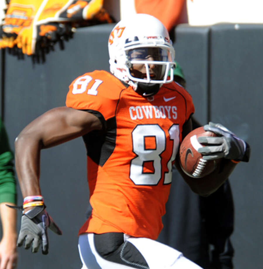 Oklahoma State wide receiver Justin Blackmon was named the offensive player of the year on the Express-News All-Big 12 Team.