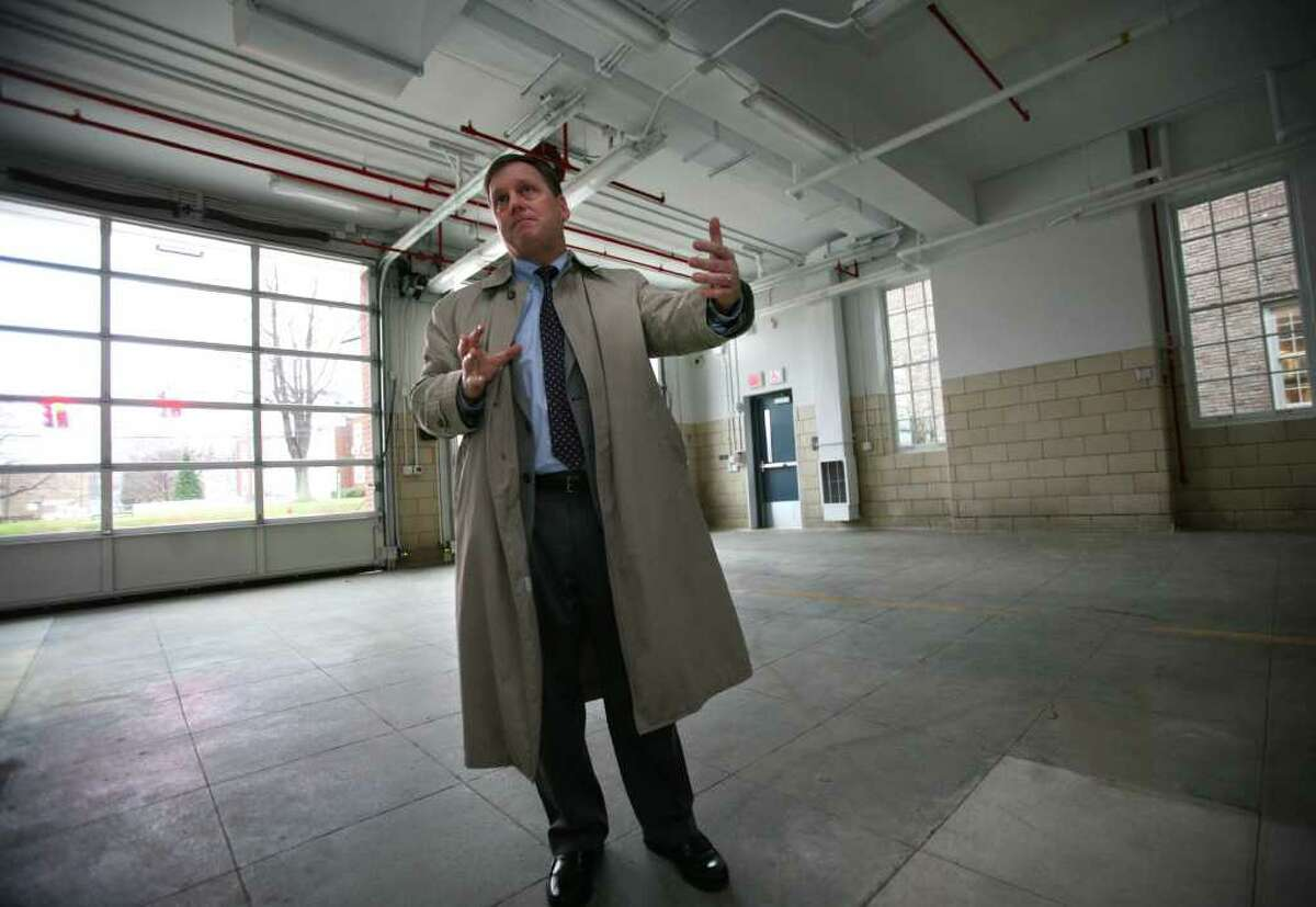 Stratford Mayor John Harkins gives a tour of the new Stratford EMS building on Wednesday, December 1, 2010. The renovated building was the former Main Street fire station which was left empty after the new fire headquarters was constructed next door.