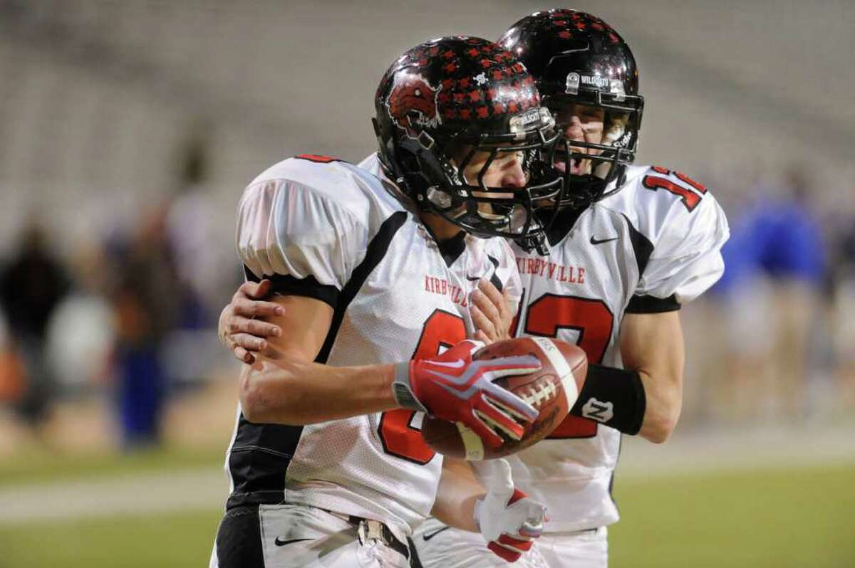 Kirbyville's Caleb Cucancic is congragulated by quarterback Kael Jones after a touchdown carry in the second half against the Comfort Bobcats in Class 2A Division I state semifinal playoff game at Baylor University in Waco. Saturday, December 5, 2009. Valentino Mauricio/The Enterprise