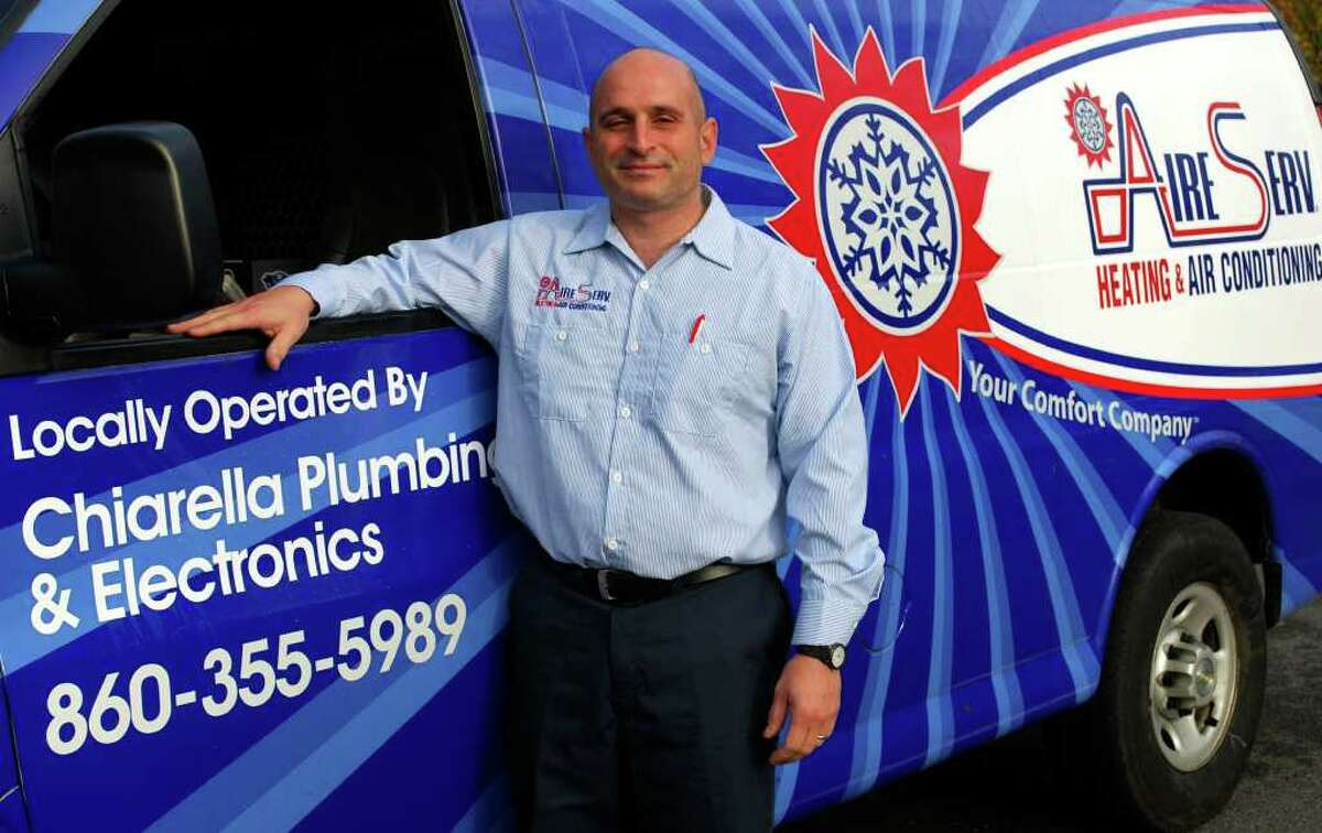 SPECTRUM/Michael Chiarella and his wife, Rusty, not shown, are the co-owners of Aire Serv of Western Connecticut in New Milford. The company provides air conditioning and heating services. For Greater New Milford Chamber of Commerce Business Quarterly for December 2010.