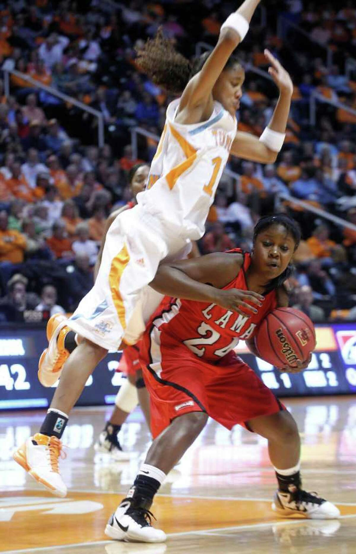 Tennessee's Meighan Simmons, left, falls over Lamar's Ang Green (24) during the first half of an NCAA college basketball game Wednesday, Dec. 1, 2010, in Knoxville, Tenn. (AP Photo/Wade Payne)