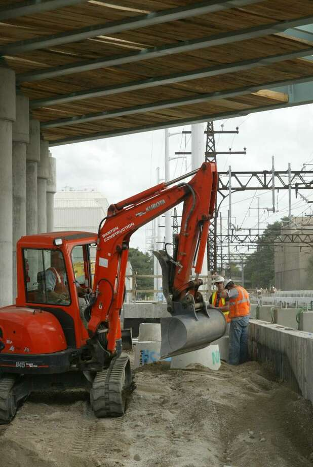 Construction crews work on the southbound platform at the new Fairfield Metro North Station, Thursday, Sept. 10, 2009. Photo: Phil Noel / Connecticut Post