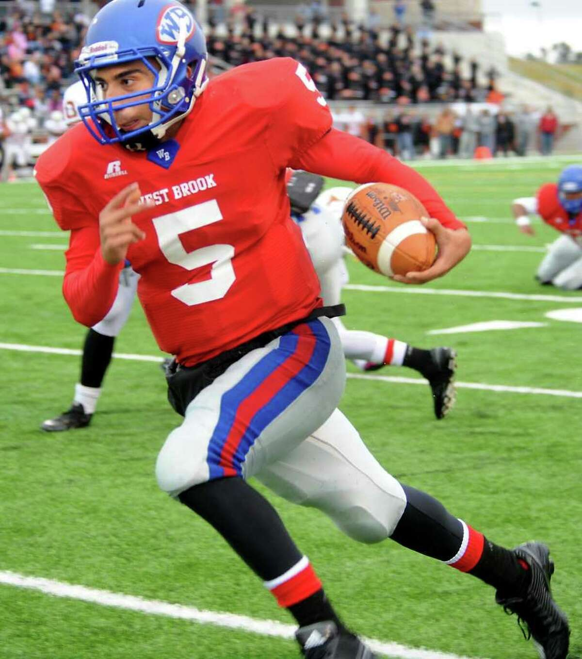 West Brook's Bruce Reyes runs the ball against Dobie during the first half of the play off game at the Carrol A.