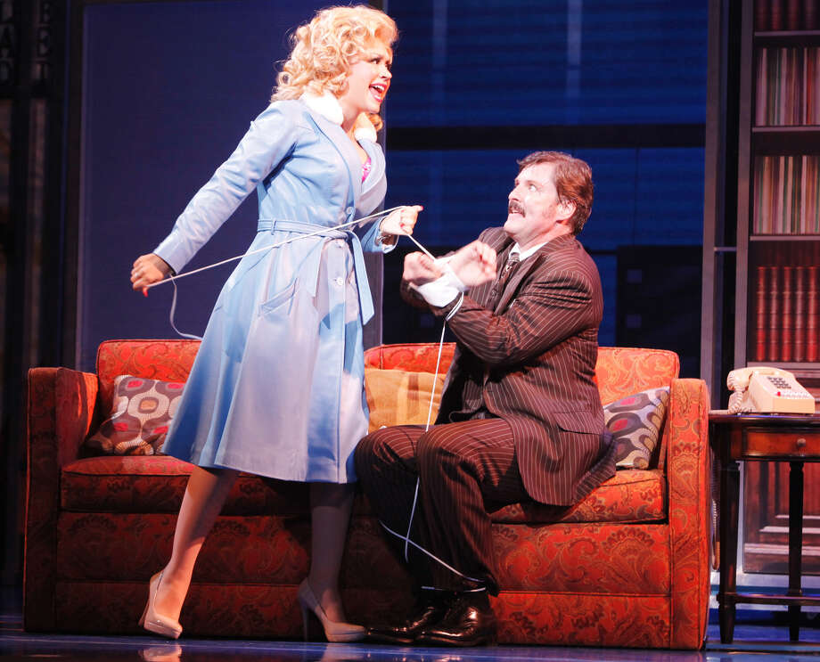 "Doralee (Diana DeGarmo) takes her boss, Franklin Hart Jr. (Joseph Mahowald) out of action in a scene from ""9 to 5: The Musical."""