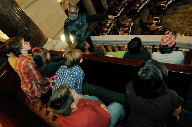 Tour guide Marvin Wallace talks about the history of the state Senate chamber to a group of Shenendehowa school district children during a tour of the Capitol Wednesday in Albany. Budget cuts are eliminating two full-time and two part-time tour jobs, the CSEA says. ( Michael P. Farrell/Times Union ) Photo: Michael P. Farrell