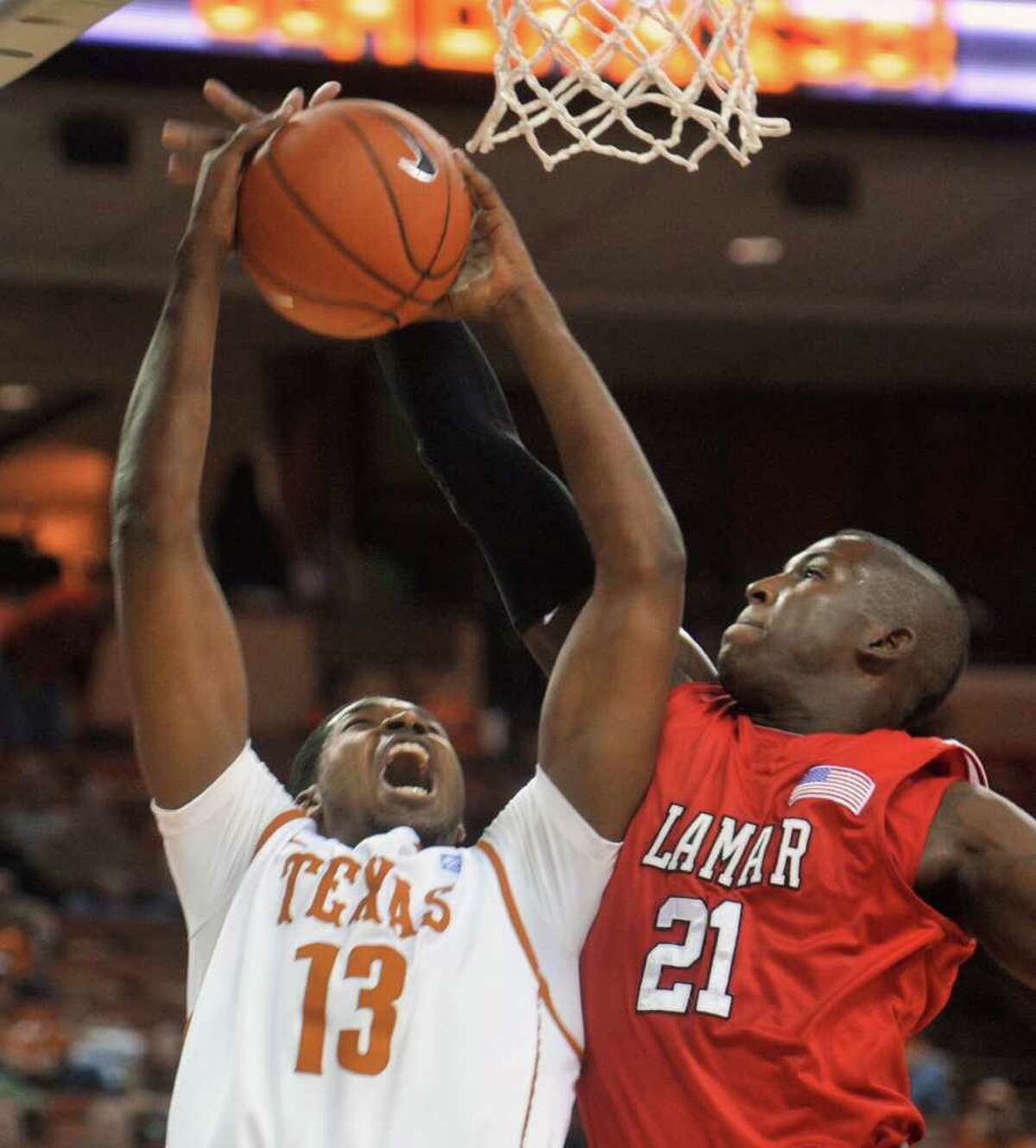 Texas center Tristan Thompson, left, goes up for a shot against Lamar guard Charlie Harper during the first half of an NCAA college basketball game in Austin, Texas, Wednesday, Dec. 1, 2010. (AP Photo/Michael Thomas)