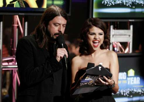 Dave Grohl, left, and Selena Gomez announce the nominees for song of the year at the Grammy Nominations Concert on Wednesday, Dec. 1, 2010, in Los Angeles. (AP Photo/Matt Sayles) Photo: Matt Sayles