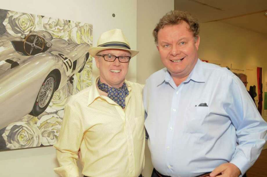 """Artist Steven Vaughan and patron Charles Mallory with Vaughan's """"hand-embellished"""" print of his """"Benz and Roses"""" original painting at the Samuel Owen Pop-Up Gallery.  The second photo is Steven Vaughan with Charles Mallory at the pop-up gallery. Photo: Contributed Photo / Stamford Advocate Contributed"""