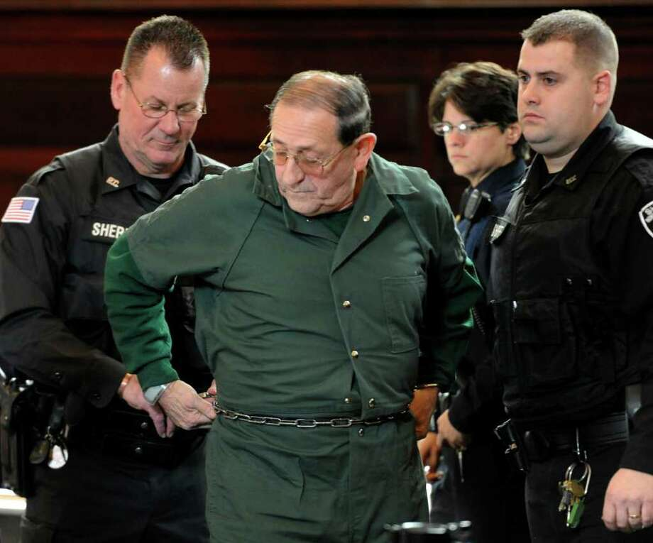 Lee Lashway is taken away after being sentenced to 25 years to life in prison on sex abuse convictions in the Rensselaer County Courthouse in Troy Dec. 2.       (Skip Dickstein / Times Union) Photo: SKIP DICKSTEIN / 2008
