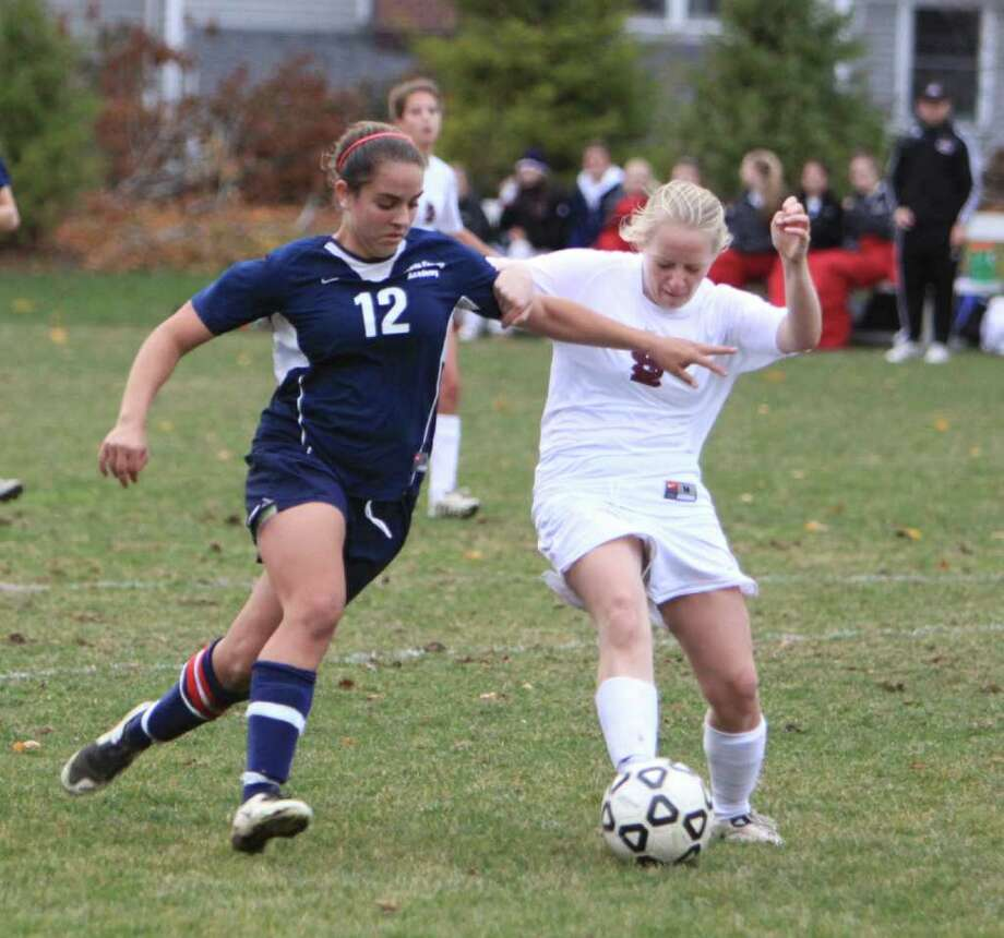 Greens Farms Academy senior Jenna Pittleman (Weston), left, was a strong defender for the Dragons, leading them to the semifinals of the New England Tournament. Photo: Contributed Photo / Matt Hintsa