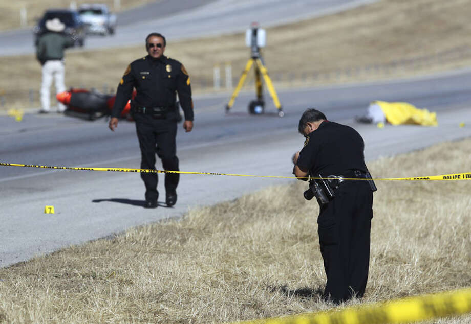 Law enforcement investigates the scene of a shooting on IH-10 west near Boerne, Texas after a man set fire to a house in San Antonio and fled west on the interstate on a motorcycle. Police from San Antonio and Boerne shot the man who allegedly had a gun.