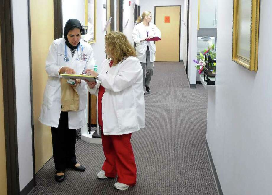 Dr. Jehanara Ahmed and Susanna Hamby talk in the halls at the Joslin Diabetes Center on Monday. The center will open its doors to the public today. Guiseppe Barranco/The Enterprise Photo: Guiseppe Barranco / Beaumont