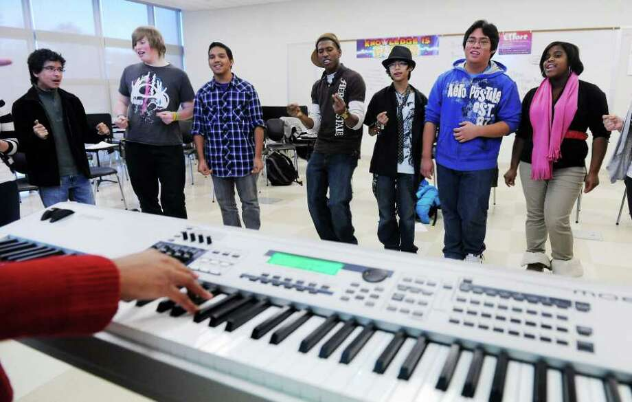 Students in the glee club at AITE rehearse a dance routine for an upcoming concert in Stamford, Conn. on Thursday December 2, 2010.   The club will perform at the Stamford Town Center on December 14 from 4:00pm-6:00pm. Photo: Kathleen O'Rourke / Stamford Advocate