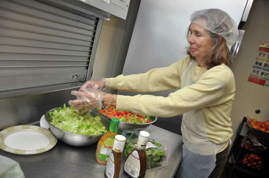 Sara Rehmberg prepares a salad in the kitchen at the Shelter for the Homeless on Pacific Street in Stamford on Thursday, Nov. 18, 2010. Photo: Amy Mortensen / Connecticut Post Freelance