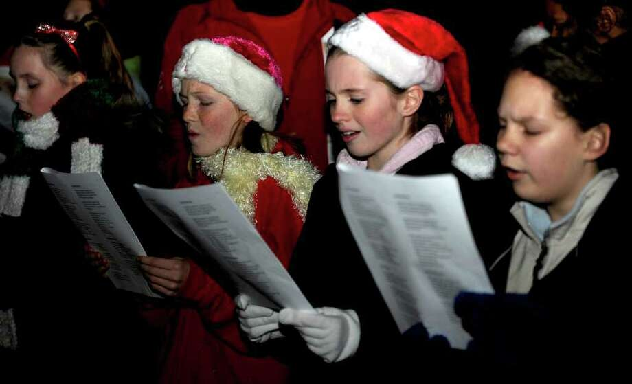 Carolers sing during the Stratford Christmas Tree Lighting Festival on Thurdsay, November 2, 2010. Photo: Lindsay Niegelberg / Connecticut Post