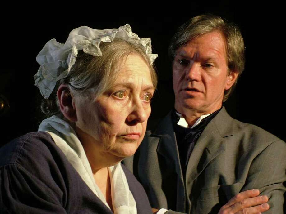 """Ruth Anne Baumgartner of Fairfield as Elizabeth and Peter Wood of Stratford as Jack Manningham in a scene from """"Angel Street,"""" now playing at the Westport Community Theatre. Photo: Contributed Photo"""