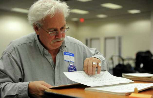 John Murphy helps re-count ballots at the City Hall Annex on Thursday, November 2, 2010. Photo: Lindsay Niegelberg / Connecticut Post