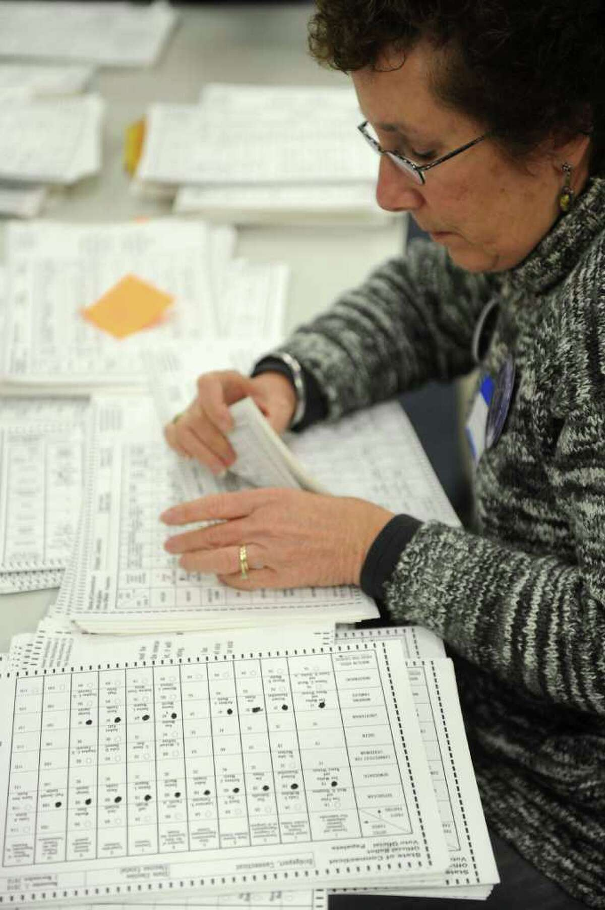 Yvonne Senturia helps re-count ballots at the City Hall Annex on Thursday, November 2, 2010.